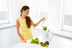 Healthy Lifestyle. Happy Vegetarian Woman Making Detox Smoothie. Royalty Free Stock Image