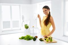 Healthy Lifestyle. Happy Vegetarian Woman Making Detox Smoothie. Stock Photo