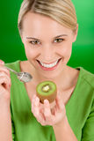 Healthy lifestyle - happy woman holding kiwi Stock Photos