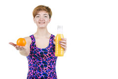 Healthy lifestyle, healthy eating. Young girl with a bottle of orange juice and orange, smiling, on a white isolated background. H stock images