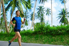 Healthy Lifestyle. Jogger Running. Sporty Runner Man Jogging. Sp Royalty Free Stock Photos