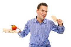Healthy lifestyle man eating crispbread and apple Stock Photo