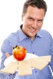 Healthy lifestyle man eating crispbread and apple Stock Photos