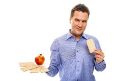 Healthy lifestyle man eating crispbread and apple Stock Image