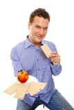 Healthy lifestyle man eating crispbread and apple Royalty Free Stock Photography