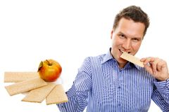 Healthy lifestyle man eating crispbread and apple Stock Images