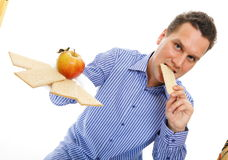 Healthy lifestyle man eating crispbread and apple Royalty Free Stock Images