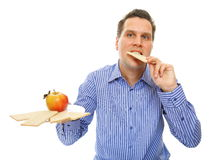 Healthy lifestyle man eating crispbread and apple Royalty Free Stock Photos