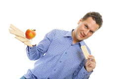 Healthy lifestyle man eating crispbread and apple Stock Photography
