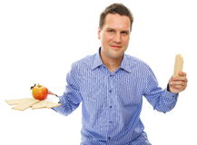 Healthy lifestyle man eating crispbread and apple Royalty Free Stock Image