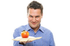 Healthy lifestyle man eating crispbread and apple Stock Photo