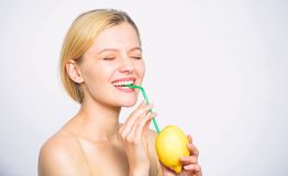 Healthy lifestyle and organic nutrition concept. Girl drink fresh juice whole lemon fruit with cocktail straw. Benefits. Of drinking lemon water in morning stock photos