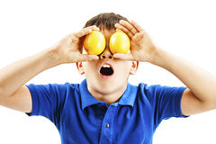 Healthy lifestyle people. Funny image of little boy showing lemons Stock Photo