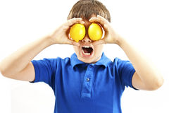 Healthy lifestyle people. Funny image of little boy showing lemons Royalty Free Stock Photography