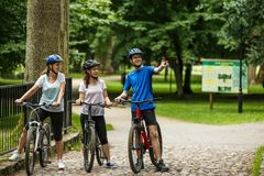 Healthy lifestyle - people riding bicycles in city park Stock Photo
