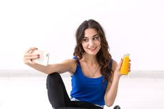 Healthy lifestyle, people and sport concept - Woman taking selfie and holding juice stock photos