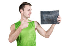 Healthy lifestyle. Portrait of a handsome guy with an empty signboard for writing, wearing sportswear, isolated on white backgroun Stock Images