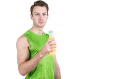 Healthy lifestyle. Portrait of a handsome guy with juice, wearing sportswear, isolated on white background, looking at camera. Hor Stock Photo