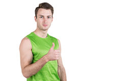 Healthy lifestyle. Portrait of a handsome guy in sportswear, isolated on white background, looking at camera, thumbs up. Horizonta Royalty Free Stock Photo