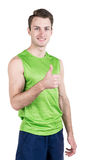Healthy lifestyle. Portrait of a handsome guy in sportswear, isolated on white background, looking at camera, thumbs up. Vertical Royalty Free Stock Images