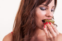 Healthy lifestyle - portrait of young beautiful woman eating a p Stock Image
