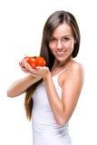 Healthy lifestyle! Pretty woman holding a tomato Royalty Free Stock Photos