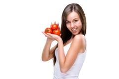 Healthy lifestyle! Pretty woman holding a tomato Stock Photo