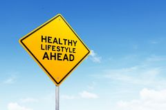 Healthy lifestyle road sign over beautiful sky. stock photos