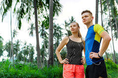 Healthy Lifestyle. Runner Couple Preparing To Jog. Fitness And S Royalty Free Stock Photos