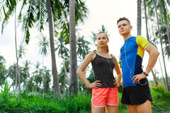 Healthy Lifestyle. Runner Couple Preparing To Jog. Fitness And S Stock Photo