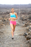 Healthy lifestyle runner woman trail running Stock Photo