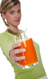 Healthy lifestyle series - Woman with carrot juice Royalty Free Stock Photos