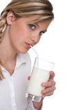 Healthy lifestyle series - Woman drinking milk Royalty Free Stock Image