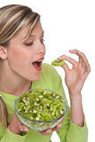 Healthy lifestyle series - Woman eating kiwi Royalty Free Stock Image