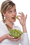 Healthy lifestyle series - Woman eating kiwi Stock Photo