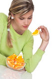 Healthy lifestyle series - Woman eating orange Stock Image
