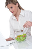 Healthy lifestyle series - Woman eating salad Royalty Free Stock Photography