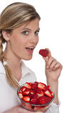 Healthy lifestyle series - Woman eating strawberry Royalty Free Stock Image