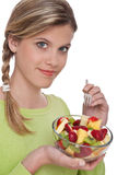 Healthy lifestyle series - Woman with fruit salad Stock Photos