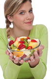 Healthy lifestyle series - Woman with fruit salad Royalty Free Stock Photography