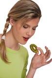 Healthy lifestyle series - Woman holding kiwi Royalty Free Stock Photos