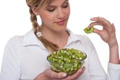 Healthy lifestyle series - Woman holding kiwi Stock Image