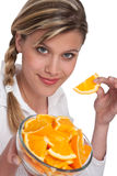Healthy lifestyle series - Woman holding orange Royalty Free Stock Photo