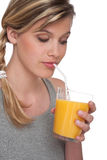 Healthy lifestyle series - Woman with orange juice Royalty Free Stock Photo