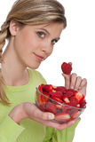 Healthy lifestyle series - Woman with strawberries Stock Photos