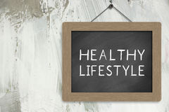 Healthy Lifestyle Sign. Blackboard hanging on the wall