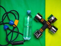 Healthy lifestyle, sport or athlete's equipment set on green background. Flat lay. Top view with copy space. Motivation concept royalty free stock image
