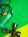 Healthy lifestyle, sport or athlete's equipment set on green background. Flat lay. Top view with copy space. Motivation concept stock photography