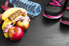 Healthy lifestyle with sport items , fruits and water Royalty Free Stock Images