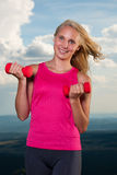Healthy lifestyle sport success - fit blond woman workout with d Stock Photos